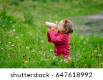 the girl drinks water from a...   Shutterstock . vector #647618992