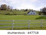 A Farm With A White Split Rail...