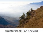 Mountains landscape with trees on rocks - stock photo