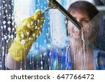 a girl washes windows at home.... | Shutterstock . vector #647766472
