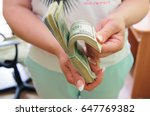 Woman Holding Money In Her Hands