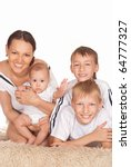 nice family of four on a white | Shutterstock . vector #64777327