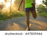 young female runner warming up... | Shutterstock . vector #647835466