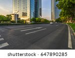 empty asphalt road front of... | Shutterstock . vector #647890285
