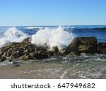 Waves Crashing Over The Rocks...