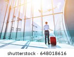 businessman at airport terminal ... | Shutterstock . vector #648018616