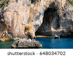 little boat stop by the cave... | Shutterstock . vector #648034702