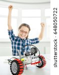 Small photo of Selective focus on a robot happy young girl celebrating success in victorious gesture with her arms raised in the air copyspace successful victory winning achieving achievement happiness education