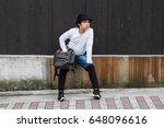 asian boy is wearing the street ... | Shutterstock . vector #648096616