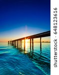 sunrise in an old pier | Shutterstock . vector #648123616