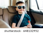 child in the car with  fasten... | Shutterstock . vector #648132952