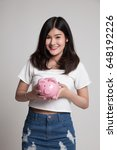 young asian woman with a pig... | Shutterstock . vector #648192226