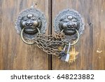 doors closed with chains.... | Shutterstock . vector #648223882