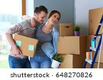 happy young couple unpacking or ... | Shutterstock . vector #648270826