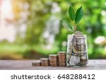 plant growing coins in glass ... | Shutterstock . vector #648288412