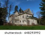low angle of large abandoned... | Shutterstock . vector #648293992