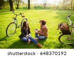charming young women sit on a... | Shutterstock . vector #648370192