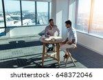 business partners in happy mood ... | Shutterstock . vector #648372046