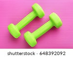 green dumbbells on pink... | Shutterstock . vector #648392092