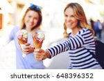 two young women holding ice... | Shutterstock . vector #648396352