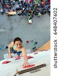 young female climber touching... | Shutterstock . vector #648407602