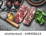 two dry aged raw beef steaks... | Shutterstock . vector #648408616