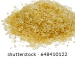 Small photo of cane sugar unrefined, dry demerara isolated on the white background