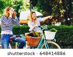 two young women tourists... | Shutterstock . vector #648414886