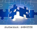 Dark blue puzzles.  It is a metaphor (the beginning; opening; end). - stock photo