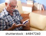 senior man doing blood sugar... | Shutterstock . vector #64847260
