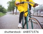 bicycle ride in the rain. close ...   Shutterstock . vector #648571576