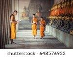 Novice Monks Reading Book...