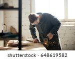tradesman in protective clothes ... | Shutterstock . vector #648619582