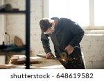 tradesman in protective clothes ... | Shutterstock . vector #648619582