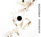 Small photo of Fashion blog gold style desk with woman accessory collection: golden watches, scissors, coffee cup, notebook and cotton branch on white background. Flat lay. Top view.