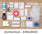 first aid kit on wooden... | Shutterstock . vector #648628402