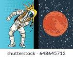 cosmonaut knocks head on the... | Shutterstock .eps vector #648645712