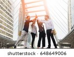 new business team  giving five... | Shutterstock . vector #648649006