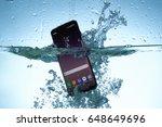 galaxy s8 in water | Shutterstock . vector #648649696