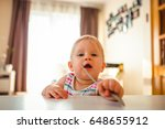 adorable baby girl standing at... | Shutterstock . vector #648655912