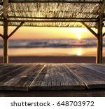 empty bar table against sunset... | Shutterstock . vector #648703972