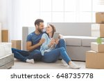 young couple moving to a new... | Shutterstock . vector #648735778