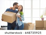 young couple moving to a new... | Shutterstock . vector #648735925