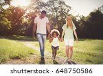 happy family walking in nature... | Shutterstock . vector #648750586