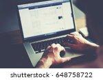 cropped shot of a man's hands... | Shutterstock . vector #648758722