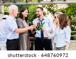 office colleagues drinking beer ... | Shutterstock . vector #648760972