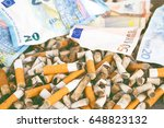 cigarette butts with euro... | Shutterstock . vector #648823132