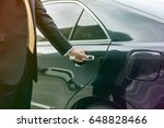 businessman opening limo car... | Shutterstock . vector #648828466