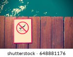 Sign Of No Diving On Wooden Pier