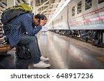 asian depressed traveler... | Shutterstock . vector #648917236